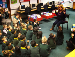 Foundation Year sat smartly listening to a librarian reading a story